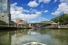 Take the Zubizuri bridge to cross the Nervion River