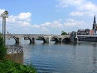 Crossing the Meuse river by walking the St. Servaasbrug