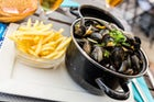 "Savor the classic ""Mussels and fries"" in Ostende"