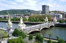 Cross the river on Maria Cristina Bridge
