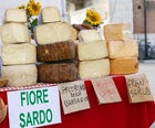 Buy a pecorino sardo in a local market
