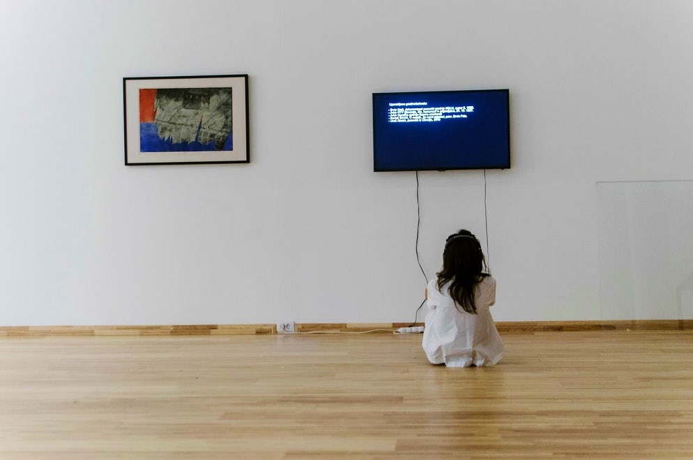 Girl watching a video in the museum © Credits to The Museum of Contemporary Art of Vojvodina / Facebook