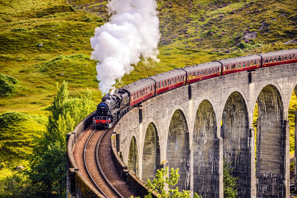 Glenfinnan Railway Viaduct in Scotland with the Jacobite steam train passing over - Picture Credtis to miroslav_1