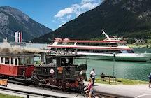 En train à vapeur et en bateau, direction Achensee