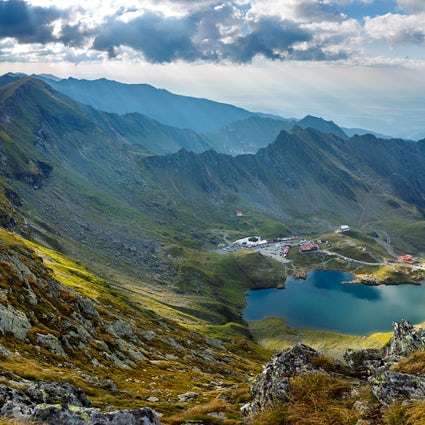 A waterfall and a lake on top of the mountains - Bâlea Lake